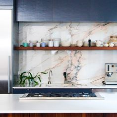 Navy kitchen, marble