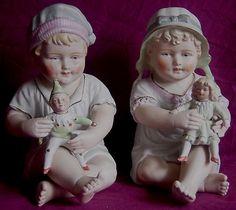 Pair of antique German piano babies.
