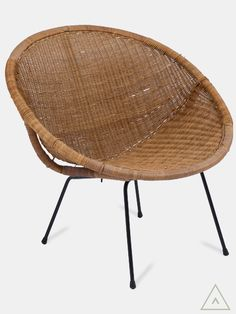 Vintage 1950's wicker tub chair on tubular metal legs.  Explore interior design inspiration and shop vintage furniture, antique furniture, contemporary furniture and mid-century designs.