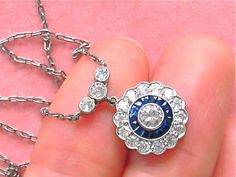 *PLEASE VISIT BOTH MY STORES:  MELS ANTIQUE JEWELRY and MELS ANTIQUE JEWELRY TOO  This is an ESTATE PENDANT NECKLACE that was made in the ART DECO STYLE, post 1950, from PLATINUM, including the 16-3/4 chain. The chain has an 18k white gold spri...