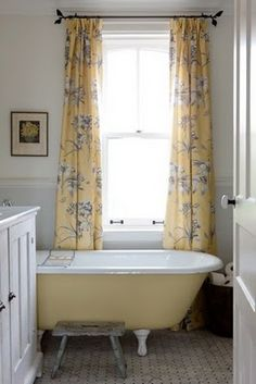 Light gray walls with yellow drapes like this.