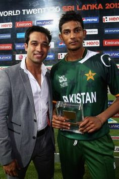 Raza Hasan (2 wikt for 14) with his 'Man of the Match' award vs Australia, World T20, Colombo 2 Oct 2012