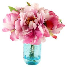 Create a lush tablescape or charming vignette with this lovely faux peony arrangement, featuring bright blossoms nestled in a mason jar-inspired vase.