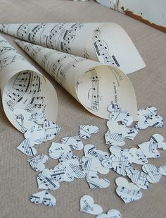 Paper Favor Cones 25 Wedding by roseflower48 on Etsy, $23.00....what a cute idea....could add paper punched colors to match the wedding and add birdseed too! Love this for a musician's wedding....