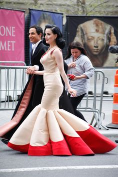 The Candid Met Gala Pics You Haven't Seen #refinery29  http://www.refinery29.com/2014/05/67476/met-ball-street-style#slide1  Zac Posen is a true gentleman with Dita Von Teese.