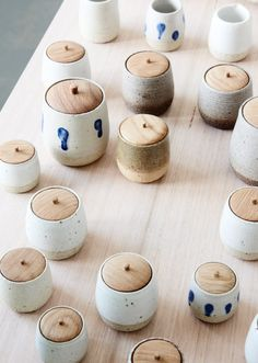 A range of distinctive ceramics vessels with hand turned timber lids, created in North Melbourne by young creative couple Asuka Mew and Anna Miller-Yeaman.