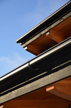 Beautiful black half-round gutter, with outside fascia brackets. Custom work, on a custom home! Exterior Trim, Exterior Paint, Vancouver Island, House Gutters, Fascia Board, Seamless Gutters, House Trim, Trim Color, Reno