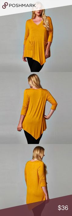 {Plus} V-Neck Tunic with Front Pockets *Wardrobe Staple Piece*  This gorgeous mustard color tunic features a v-neck, two front pockets and 3/4 sleeves.   Slightly fitted through the bust and starts to flare towards the hem, giving a flattering fit.   Pair with your favorite jeans and a cute statement necklace!   • 95% polyester, 5% rayon • Made in USA! • Fabric is very soft and stretchy  • Available in size 1X, 2X & 3X  🔺 Measurements provided in comments below. 🔺 dottie + chloe Tops…