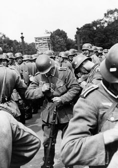 Campaign In The West (Battle Of France) 1940: German entry into Paris - Soldiers at the Champs Elysees after after having been decorated with the iron cross medal.