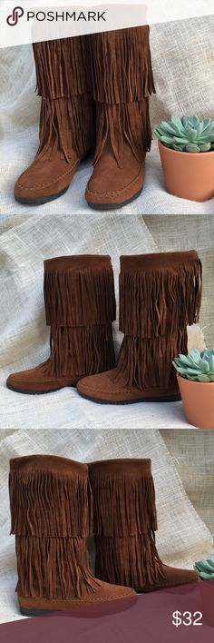 Rampage Boots Cognac Fringe Moccasin Boho Festival Very nice condition pre-owned fringe moccasin boots in the color Cognac. High rise boots, which stop at the calf. Two layers of fringe and moccasin style round toe and heel. The insole foot beds are clean. Outside and outsoles are in great condition. So cute and comfy!!! Great for this Fall and Winter! Man made material, faux suede Style name: Capello, Style # MI1012 One flaw: one single fringe at the backside of the left boot is missing…