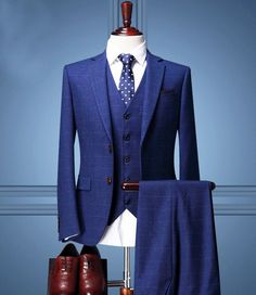 Modern day tuxedos don't have to be black or gray. Dare to be different by playing with colors like blue & purple.