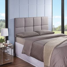 The Tarina Headboard's grid stitching detail gives a hint of glam to its minimalist silhouette. On-trend yet classically elegant, this scene-setter is wrapped in soft foam for the look and feel of plush comfort.