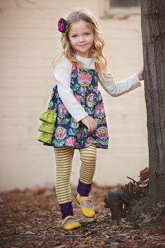Olivia jumper is complete happiness all packaged up into one little number. She is adorned down the back with 3 rows of contrast ruffles, a delightful and whimsical fabric with a grey ground that make