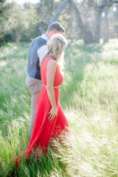 Yes to a statement red dress for your engagement shoot! Photo by Troy Grover Photographers