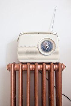 Copper spray painted radiator & vintage radio.
