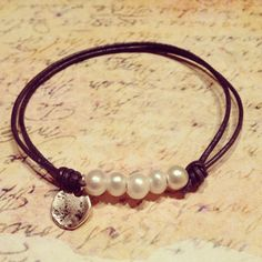 Freshwater pearls & leather bracelet with silver charm & sliding closure . . . . ღTrish W ~ http://www.pinterest.com/trishw/ . . . . #handmade #jewelry #knotting