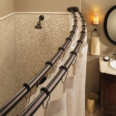 Moen Old World Bronze Double Curved Shower Rod at Bed Bath & Beyond. This double curved shower rod, designed to separate shower curtain from liner, adjusts from to and has decorative covers to add an elegant look while concealing screws. Small Bathtub, Bathtub Shower, Small Bathroom, Bathroom Ideas, Bathroom Showers, Bath Tubs, Bathroom Renovations, Unisex Bathroom, Shower Ideas