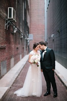 42 North Weddings // Lisa Rigby Photography // Ritz Carlton Boston // Spruce Floral // Dani Wagener Beauty // Lindsay Griffin // Night Shift Ent // Table Toppers / Peterson's Party Center // Shine Wedding Invitations // Boston Hotel Wedding
