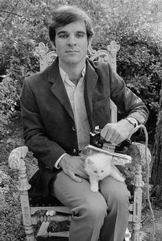 A young Steve Martin ironing a cat, 1970s.
