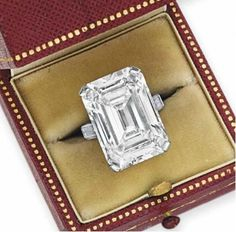 A superb diamond ring by Cartier. Center stone is approx carats. Via Diamonds in the Library. This ring was kept in a bank vault from the in it's original Cartier box of the until discovered as part of Hougett Clark estate in Diamond Rings, Diamond Engagement Rings, Diamond Jewelry, Diamond Cuts, Emerald Diamond, Emerald Cut, I Love Jewelry, Jewelry Box, Fine Jewelry