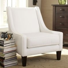 With the Wingback Chair, you'll enjoy ultimate comfort in a straightforward, traditional style. Low side arms that sweep up the back, tapered wooden legs, and a welted trim border complete this elegant an #traditional #straightforward #style
