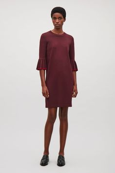 COS image 1 of Knitted dress with pleated sleeves    in Burgundy