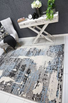 Runiullae Modern City Grey Blue Rug A marvelous exhibit of trendsetting rugs, this Collection instills life into extraordinary spaces. Expertly power-loomed in Turkey, these rugs are easy-care and virtually non-shedding. Classic designs become fashion-smart home decor in this alluring and playful collection.