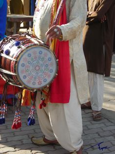 Closeup of a traditionally decorated dhol at Lok Virsa Mela, Islamabad, Pakistan. Lok Virsa Mela is a folk heritage annual event in Spring season in Islamabad, where craftsmen and craftswomen from all provinces of Pakistan gather and display their work and sell their handcrafted artwork of all kinds. There is a 'Artisans at work' segment where artisans show how they produce an artwork.  Photography: Zehra Naqavi (Architect/artist).  April 11, 2012  All photographs are watermarked.