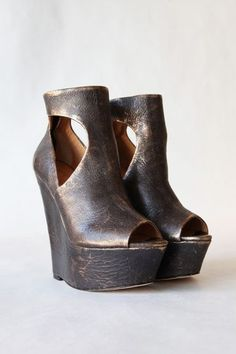 """These distressed, metallic-leather wedge booties feature an open toe and cutout sides. Hidden back zip. Covered platform and wedge heel. Leather sole. Heel: 5.75"""" 145 mm. Platform: 2"""" 50 mm. Leather: Cow. Imported. This item cannot be gift-boxed."""