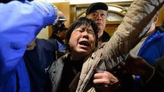 A relative (C) of passengers on Malaysia Airlines flight MH370 cries after hearing the news that the plane plunged into Indian Ocean at a hotel in Beijing on March 24, 2014. The missing Malaysia Airlines jet came down in the Indian Ocean, Prime Minister Najib Razak said March 24, as the airline reportedly told relatives it had been lost and that none on board survived. AFP PHOTO / GOH CHAI HINGOH CHAI HIN/AFP/Getty Images