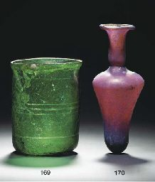 A ROMAN EMERALD GREEN GLASS BEAKER (1st Century AD) and A ROMAN AUBERGINE GLASS BOTTLE (2nd -3rd Century AD)