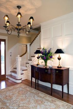 Wall color over the stairs is Putnam ivory by Benjamin Moore. CMFB #CMFB