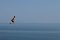 Jump from The Height - A leap from clifftop into the sea with the blue Aegean sea in the background. Visit Greece, Travel Pictures, In The Heights, Diving, Sea, Mountains, Blue, Inspiration, Travel Photos