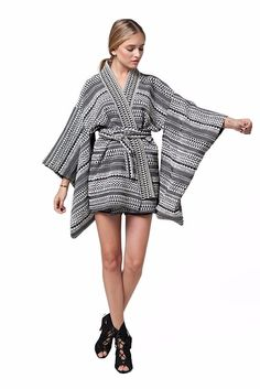 TRIBAL KIMONO SLEEVE JACKET Size: ONE SIZE Color: WOVEN TRIBAL PATTERN Material: 47% COTTON 37% POLYESTER 14% PLYAMIDE 2% ELASTIN Item Fit / Dimensions: Fits true to size, take your normal size Mid-we