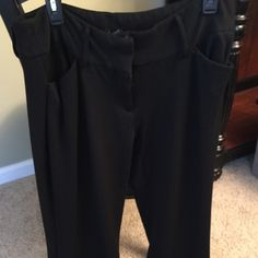 Willow Smith black pants size 12 Good condition other than a hanger imprint on top of back side on pant (see pic) which is hidden by shirt or belt when worn. Have some stretch, and I thought they were a little shorter than usual. I am 5'8 so I would recommend this to a buyer 5'6 or shorter. Priced accordingly. Smoke free and pet free home. Willi Smith Pants Trousers