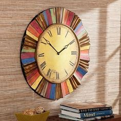 If timing is everything, why not hang it in style with this striking wall clock Make a bold statement by adding this colorful clock to your home.  This wall clock has an oversized design with classic Roman numerals and hands on a large yellow face. Surrounding the face are decorative rays of a variety of colors, rippling in waves and ridges to create interesting depth and texture. The finish of the clock is worn and scraped, for a unique and vintage look.  Try adding this wall to your living…
