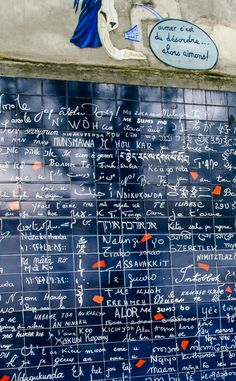 """The Wall of Love stands at the center of the Abbesses garden at Montmartre, Paris. The phrase """"I love you"""" is written more than a thousand times in over 300 different languages."""