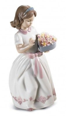 A cute little girl with flowers. Lladro.