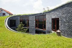 Vo Trong Nghia's Modern Blue Stone House Sports a Rising Green Roof in Viet Nam Stone House by Vo Trong Nghia Architects – Inhabitat - Sustainable Design Innovation, Eco Architecture, Green Building Green Architecture, Sustainable Architecture, Residential Architecture, Sustainable Design, Architecture Design, Pavilion Architecture, Amazing Architecture, Contemporary Architecture, Landscape Architecture
