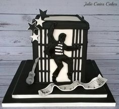 I was a bit stuck making this cake as it`s so different to my style. The person wanted an Elvis, Jailhouse Rock theme cake. I knew I couldn`t model a character to actually look like Elvis, and my painting needs lots of improvement so I went for. Elvis Birthday Party, Elvis Cakes, Music Cakes, Elvis Presley Pictures, Panda Cakes, Roll Cakes, Jailhouse Rock, Mom Cake, White Cakes