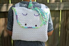 How to crochet a unicorn backpack with this beginner-friendly pattern made entirely of single crochet and chain spaces. Includes FREE pattern!