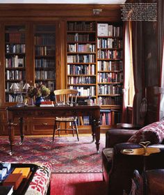 library . ottoman . rug . leather chair . wood chair by desk . via la maison boheme