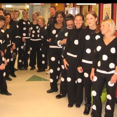 What a great last minute costume idea - dominoes! And who doesn't already have a black top and black slacks? Imagine the kids going around counting the teachers all day...