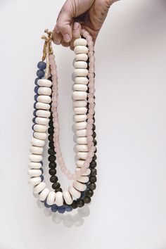 We love scouring vintage + antique markets to find unique pieces just like this necklace. Each glass bead is unique in it's color, pulling beautiful hints of navy blue. The medium sized glass beads are strung on a sturdy jute string. We love this piece as a statement necklace or as a unique home accent.