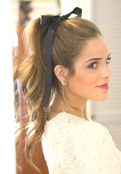 Try a sweet high ponytail with beachy waves and a bow to top off the whole look!