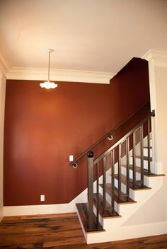 Pretty paprika wall color, would love this in our upstairs bathroom!