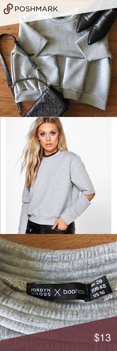Boo Hoo x Jordyn Woods cutout crop Sweater Grey cutout crop pullover. Never been worn, decided that sell it because it was way too big when I received it. Perfect for an athleisure outfit! Boohoo Tops Sweatshirts & Hoodies