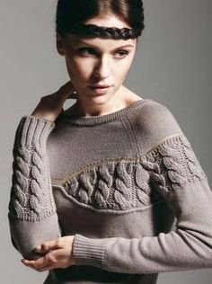 That looks amazing, would love to knit something like that - cable insets on plain garment