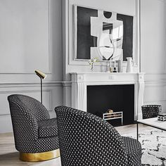 Panelled walls painted soft grey provide a sophisticated backdrop for this scheme, which artfully balances black and white upholstered furniture. Blocks of pattern, in the form of tailored cushions and artwork, add interest and personality to the modern look   Styling Claudia Bryant   Photograph Michael Sinclair   Homes & Gardens   http://www.hglivingbeautifully.com/2016/07/16/black-white-and-touches-of-grey/