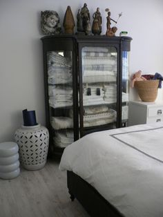 Bed linens in a glass cabinet via @Daphne Osena
